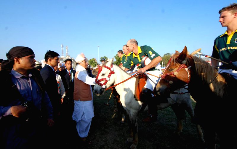 Manipur Chief Minister Okram Ibobi Singh gets introduced to the player on the opening polo match of 8th Manipur Polo International 2014 at Imphal Polo ground in Imphal on Nov 22, 2014. This .. - Okram Ibobi Singh