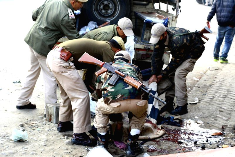 Security personnel at the site of the powerful blast that rocked Imphal, Manipur's capital city on Dec 21, 2014. Three people were killed and four others seriously injured in the blast.
