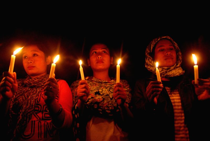 Women participate in a candlelight vigil against AFSPA (Armed Forces Special Powers Act) and to express solidarity with Anti-AFSPA campaigner Irom Chanu Sharmila in Imphal, on March 19, 2015.