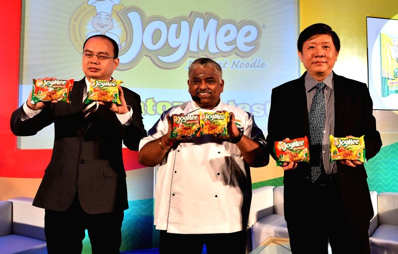 INBISCO India Country Manager Tomas Wiliam, INBISCO India Director Mulyono Nurlimo and Chef Damodaran launch a new food product in Chennai on Aug 5, 2014.