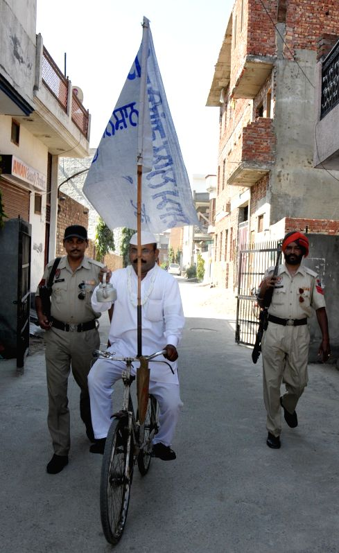 Independent candidate from Amritsar, Sham Lal during an election campaign in Amritsar on April 15, 2014.