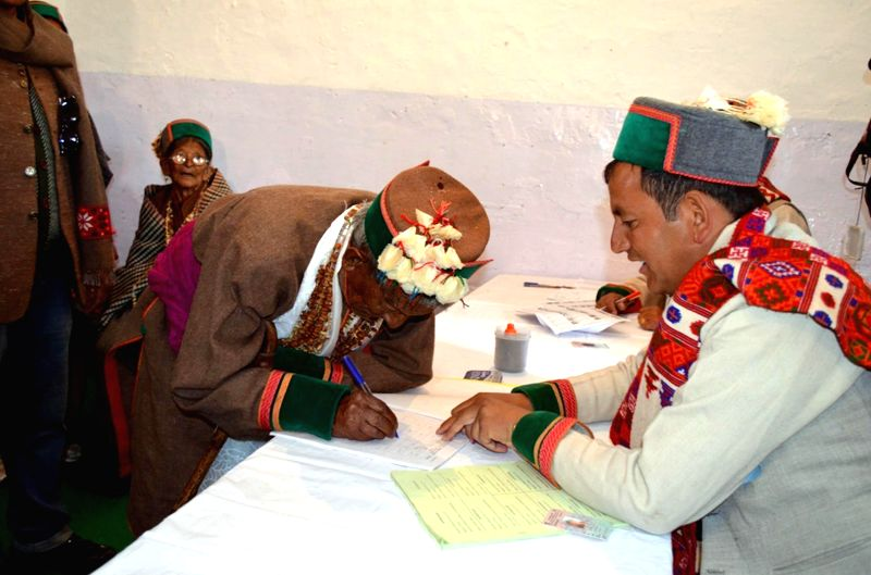 Independent India's first voter, 97-year-old Shyam Saran Negi arrives at a polling booth to cast his vote during the eighth phase of 2014 Lok Sabha Polls in Reckong Peo of Himachal Pradesh's Kinnaur .