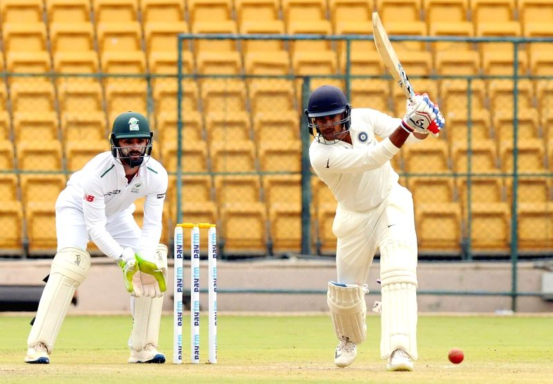 India A cricketer Mayank Agarwal in action during the 2nd day of four day test match between India A and South Africa A  at M Chinnaswamy Stadium, in Bengaluru on Aug 5, 2018.