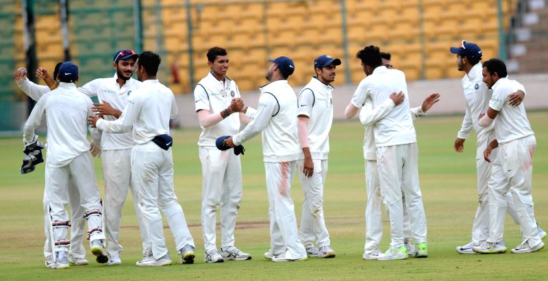 India A players celebrate after winning the first cricket test match against South Africa A on the final day of four day test match between India A and South Africa A at M Chinnaswamy ...