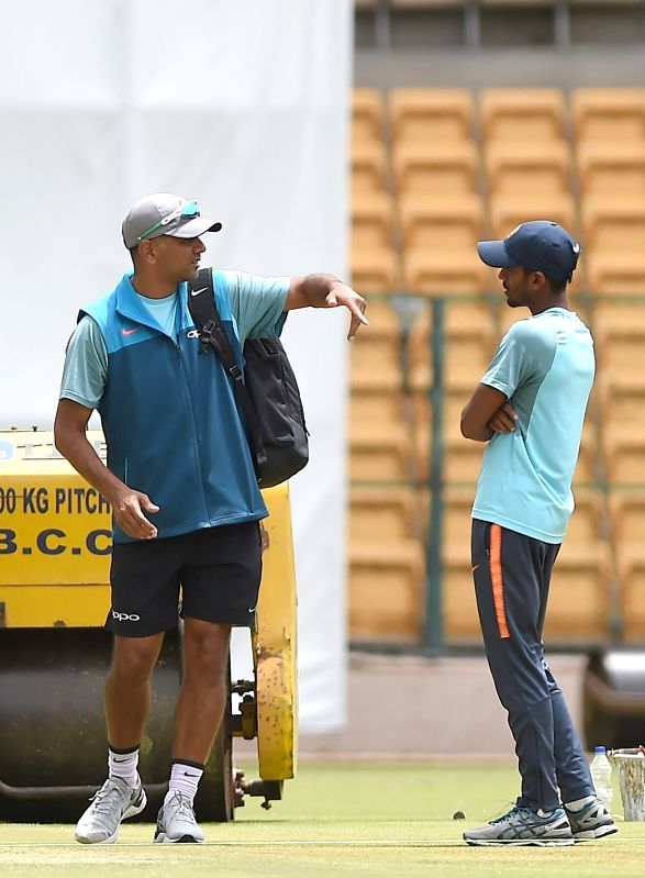 India A team coach Rahul Dravid with a player during a practice session ahead of a four-day matches against South Africa A at M Chinnaswamy stadium, in Bengaluru, on  Aug 3, 2018 - Rahul Dravid