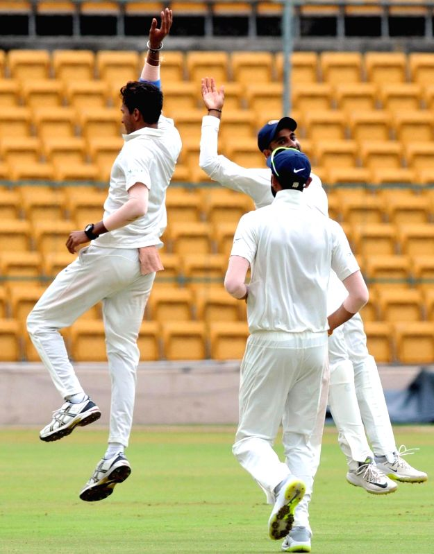 India A team players celebrate fall of Khaya Zondo's wicket on 1st day of the four day test match between India A and South Africa A at M Chinnaswamy Stadium, in Bengaluru on Aug 4, 2018.