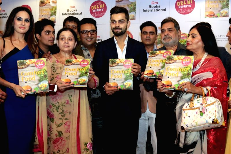 "India cricketer Virat Kohli releasing the cook book ""Comfort Food"" in New Delhi on May 31, 2016. - Virat Kohli"
