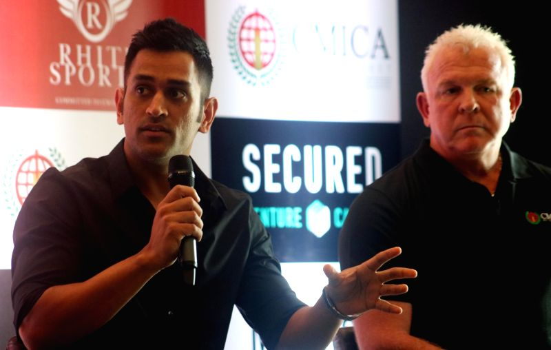 India ODI captain and global brand ambassador of Australia based Secured Venture Capital MS Dhoni and former Australian cricketer Craig McDermott during a programme in New Delhi on July ... - MS Dhoni