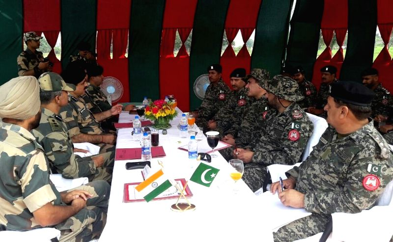 India's Border Security Force (BSF) and Pakistan Rangers during a Commandant-Wing Cadre level flag meeting on International Boundary in Samba district of Jammu and Kashmir on July 17, 2017.