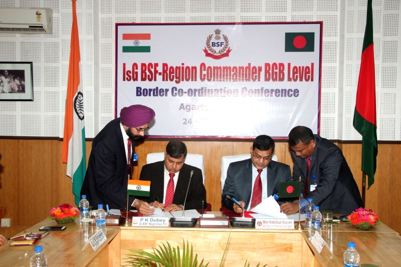 India's BSF team leader IG (Meghalaya) PK Dubey and ADG BGB Md Habibul Karim signs an document to ensure better border management through coordination, cooperation and exchange of ...
