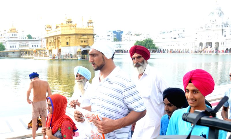 India's first National Basketball Association (NBA) player Satnam Singh Bhamara pays obeisance at the Golden Temple in Amritsar, on Aug 7, 2015.