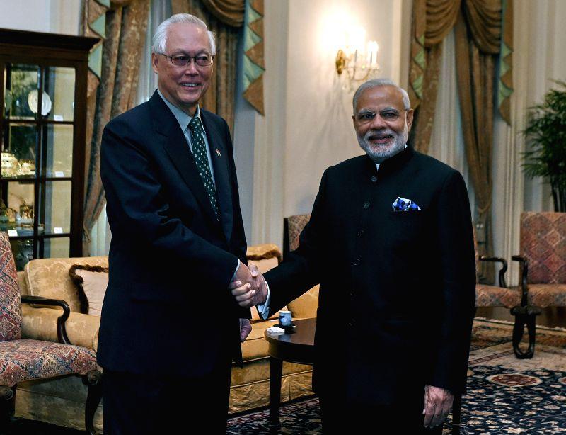 India's Prime Minister Narendra Modi (R) shakes hands with Singaporean Emeritus Senior Minister Goh Chok Tong at Singapore's Istana, Nov. 24, 2015. Modi is on the ... - Narendra Modi