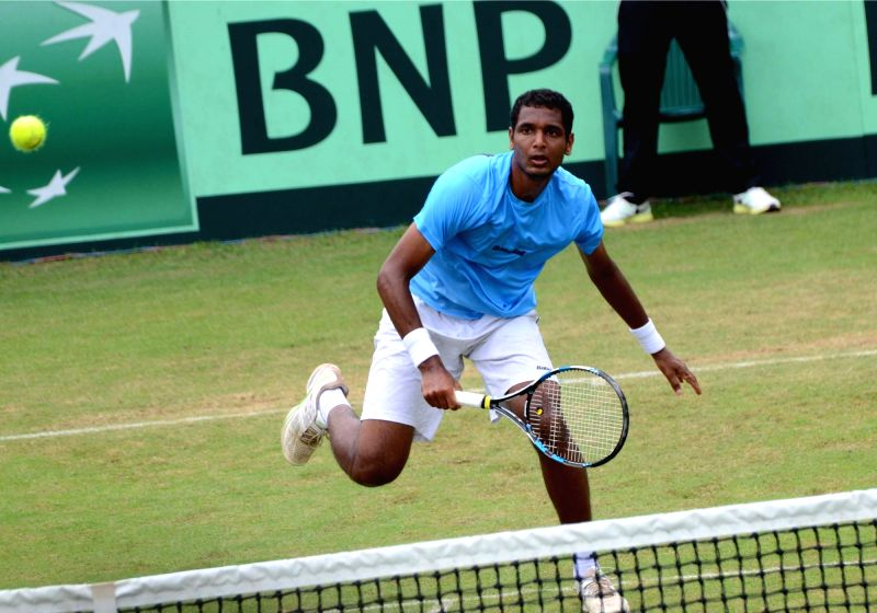 India's Ram Kumar in action against Korea's Yong-Kyu Lim during Asia/Oceania Group I 2nd Round of Davis Cup in Chandigarh on July 17, 2016. - Kumar
