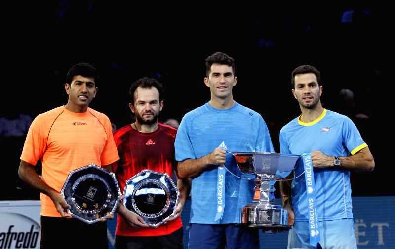 India's Rohan Bopanna and Romania's Florin Mergea hold up their runners up plate beside winners Romania's Horia Tecau and Netherland's Jean-Julien Roje (from L to R) ... - Rohan Bopanna
