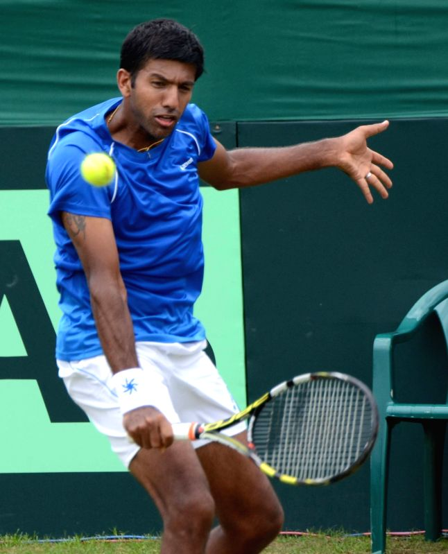 India's Rohan Bopanna in action against Korea's Hong Chung during Asia/Oceania Group I 2nd Round of Davis Cup in Chandigarh on July 17, 2016. - Rohan Bopanna