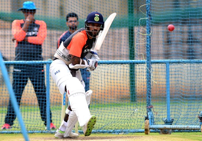 India's Shikhar Dhawan during a practice session ahead of their maiden cricket test match against Afghanistan in Bengaluru on June 12, 2018. - Shikhar Dhawan