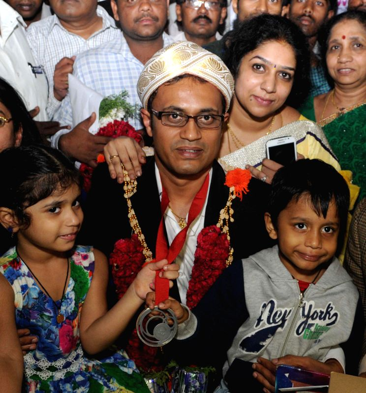 India's shooter Prakash Nanjappa, who won silver in the men's 10 metres Air Pistol shooting event at the Commonwealth Games 2014 arrives at Kempegowda International Airport in Bangalore on July 30, ..