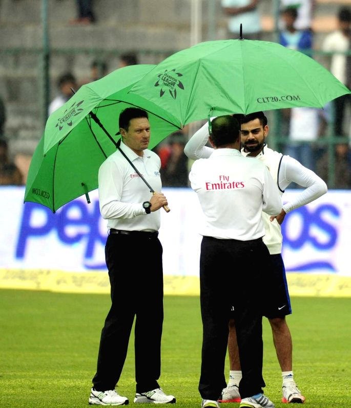 India skipper Virat Kohli interacts with umpires and match referees on the ground as rain delay the start of the 4th day of the second test match between India and South Africa at M ... - Virat Kohli