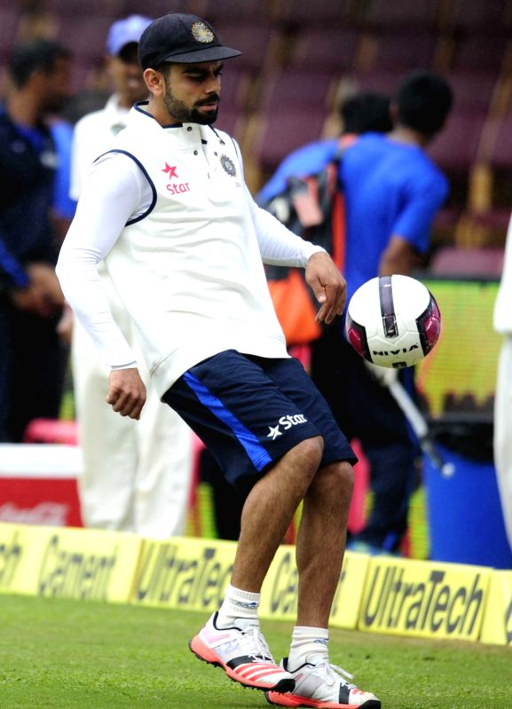India skipper Virat Kohli warm up on the ground as rain delay the start of the 4th day of the second test match between India and South Africa at M Chinnaswamy Stadium in Bengaluru, on Nov ... - Virat Kohli