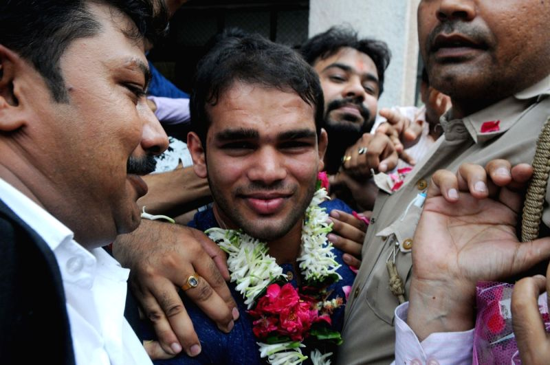 India Wrestler Wrestler Narsingh Yadav comes out after being exonerated of doping charges by the National Anti Doping Agency (NADA) panel in New Delhi, on Aug 1, 2016. - Wrestler Narsingh Yadav
