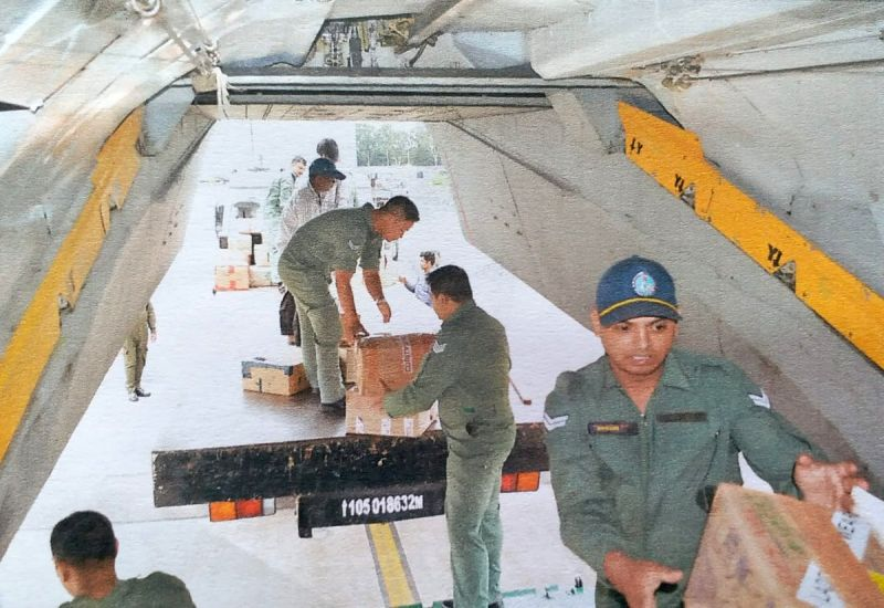 Indian Air Force (IAF) An-32 aircraft being loaded with supplies including food and other relief material for the flood-affected people of Kerala's Kochi and Trivandrum, in Bengaluru on ...