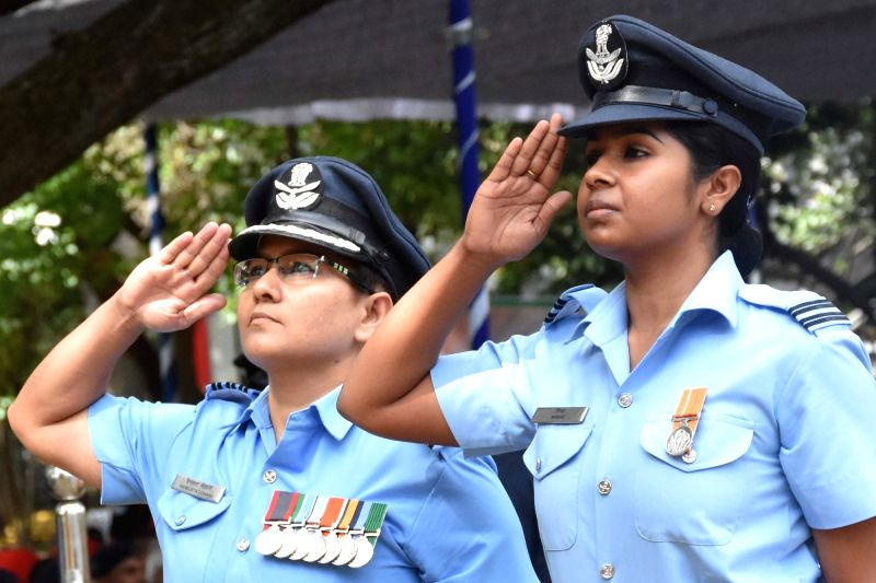 Indian Air Force (IAF) personnel pay homage to the martyrs on the occasion of Kargil Vijay Diwas at National Military Memorial Park, in Bengaluru on July 26, 2018.