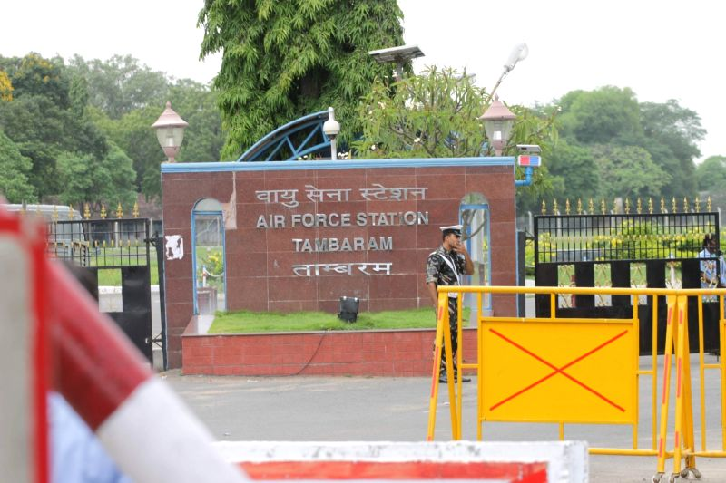 Indian Airforce personnel stand guard outside Tambaram Airforce station in Chennai on July 22, 2016. IAF's AN-32 aircraft took off from Tambaram with 29 people on board has gone missing over ...