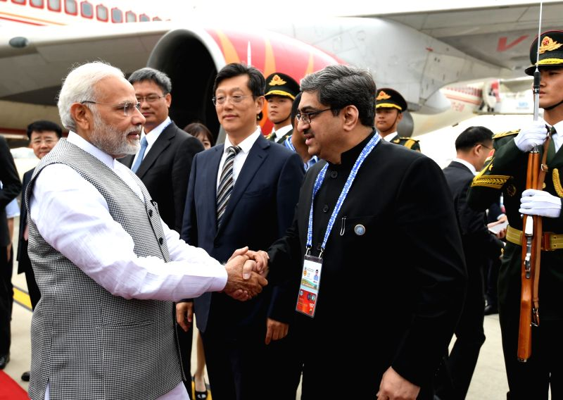 Indian Ambassador to China Gautam Bambawale receives Prime Minister Narendra Modi on his arrival to attend the Shanghai Cooperation Organisation (SCO) summit in Qingdao, China on June 9, ... - Narendra Modi