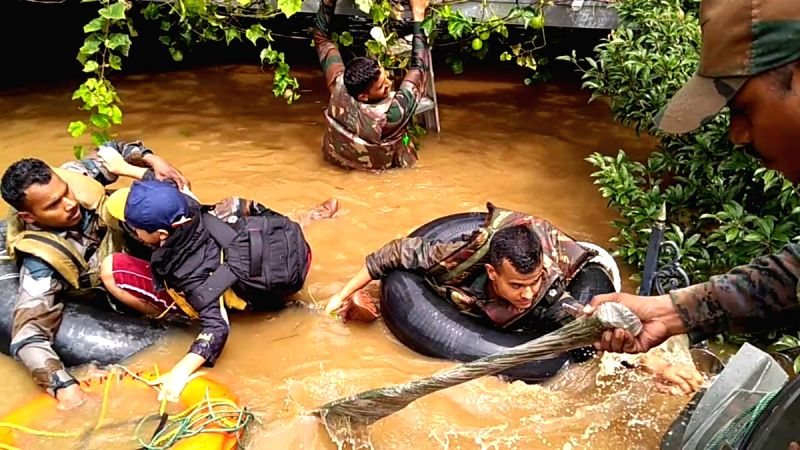 Indian Army personnel carry out rescue operations in flood-hit Kerala's Chengannur, on Aug 20, 2018.(Image Source: IANS/Twitter/@adgpi)