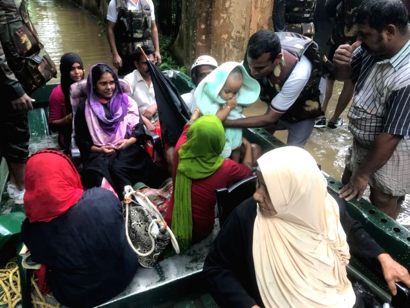 Indian Army personnel carry out rescue operations in flood-hit Kerala's Ernakulam on Aug 21, 2018.