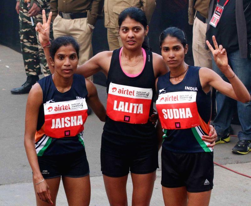 Indian athletes O P Jaisha, Lalita Shivaji Babar and Sudha Singh after the finish of Indian Elite Women event at the Airtel Delhi Half Marathon, on Nov 29, 2015. - Sudha Singh