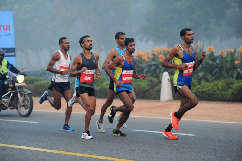 Indian athletes participate in Airtel Delhi Half Marathon 2015 at India Gate in New Delhi, on Nov 29, 2015.
