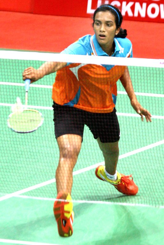 : Indian badminton player P.V. Sindhu in action against her Japanese counterpart Sayaka Takahashi during Uber Cup semi-final match at Siri Fort Stadium in New Delhi on May 23, 2014. (Photo: Amlan ...
