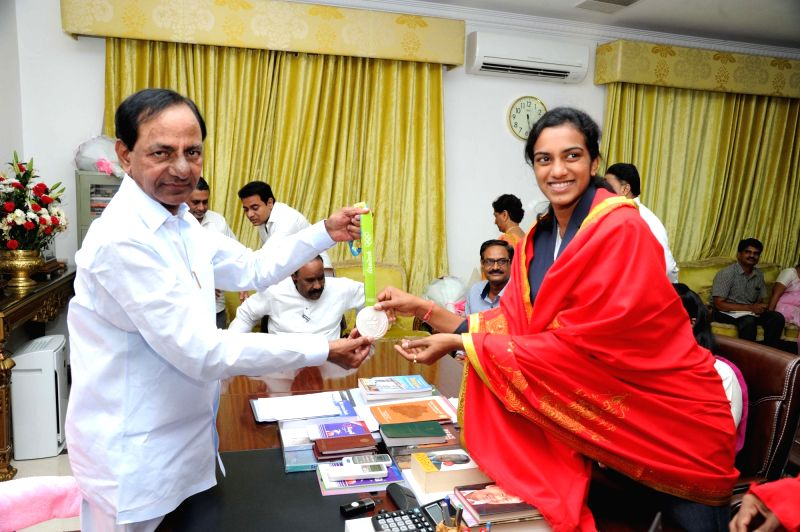 Indian badminton player P.V. Sindhu meets Telangana Chief Minister K Chandrasekhar Rao in Hyderabad on Aug 22, 2016. - K Chandrasekhar Rao