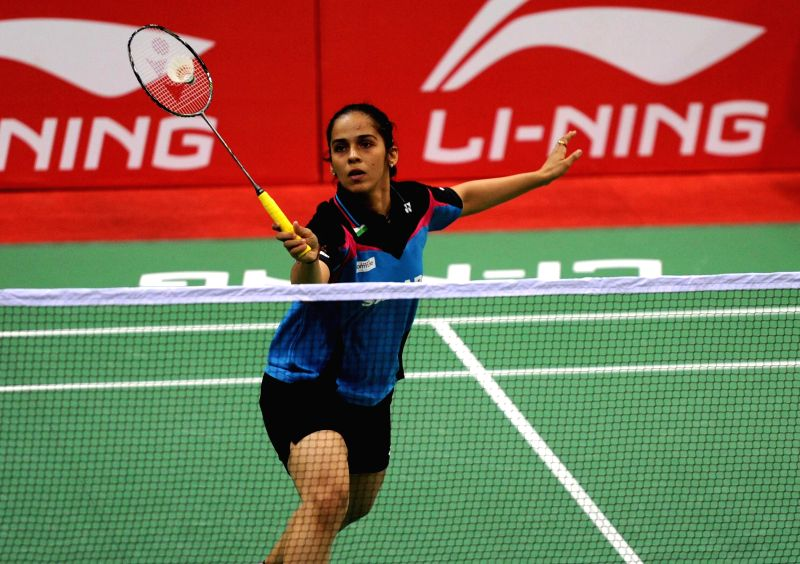 Indian Badminton player Saina Nehwal in action against her Canadian counterpart Joycelyn Ko  during a Thomas Cup and Uber Cup match at Siri Fort Stadium in New Delhi on May 18, 2014.