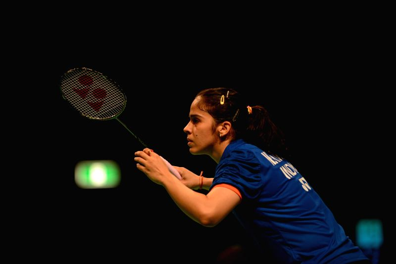 Indian badminton player Saina Nehwal in action against Japan's Eriko Hirose Rong during a match of Australian Open women's singles in Sydney, Australia on June 27, 2014.