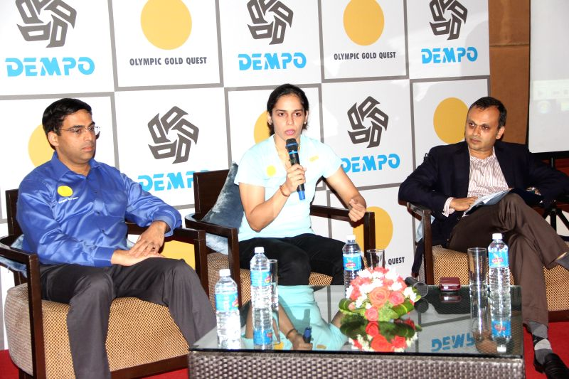 Indian badminton player Saina Nehwal with five-time World Chess champion Viswanathan Anand and Dempo Group Chairman Sriniwas Dempo during a press conference organised by Olympic Gold Quest and Dempo .
