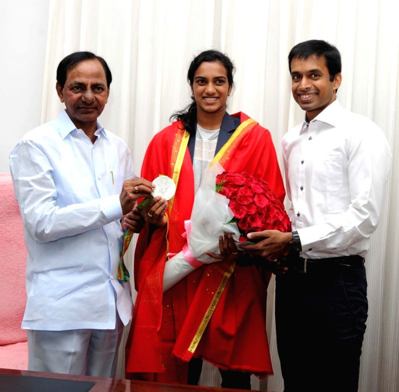Indian Badminton team coach Pullela Gopichand and Indian badminton player P.V. Sindhu meets Telangana Chief Minister K Chandrasekhar Rao in Hyderabad on Aug 22, 2016. - K Chandrasekhar Rao