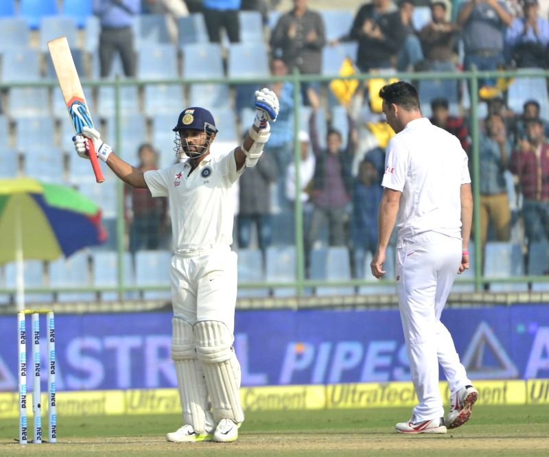 Indian batsman Ajinkya Rahane celebrates after scoring century during fourth and final cricket Test against South Africa at the Feroz Shah Kotla Stadium in Delhi on Dec. 4, 2015. - Ajinkya Rahane