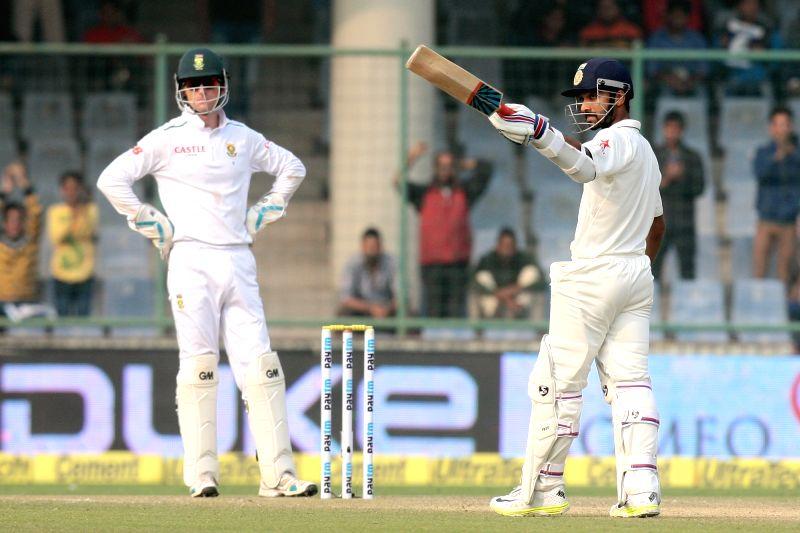 Indian batsman Ajinkya Rahane celebrates his half century during the Fourth and the final test match between India and South Africa at the Feroz Shah Kotla Stadium in New Delhi on Dec. 3, ... - Ajinkya Rahane