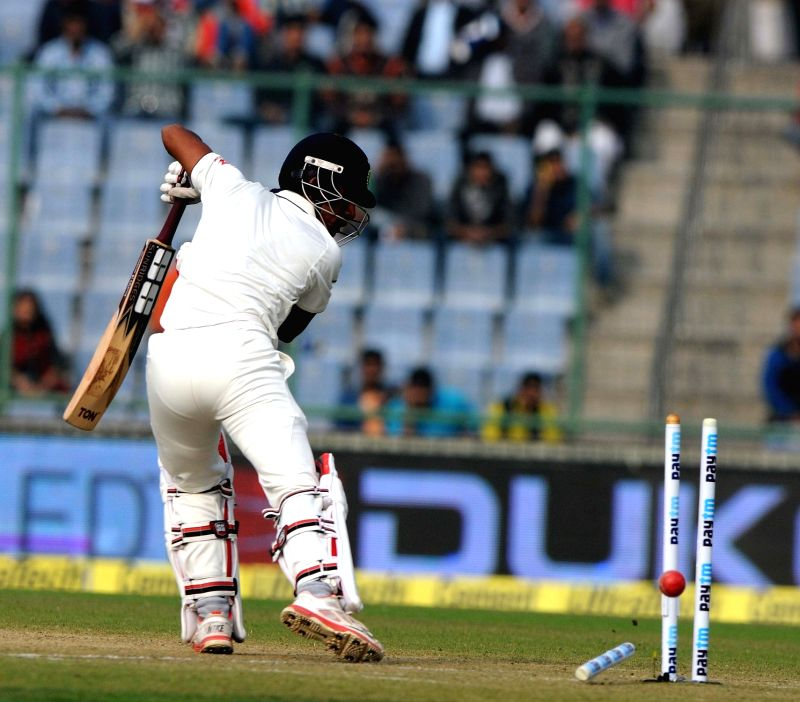 Indian batsman Wriddhiman Saha gets dismissed during the Fourth and the final test match between India and South Africa at the Feroz Shah Kotla Stadium in New Delhi on Dec. 3, 2015. - Wriddhiman Saha