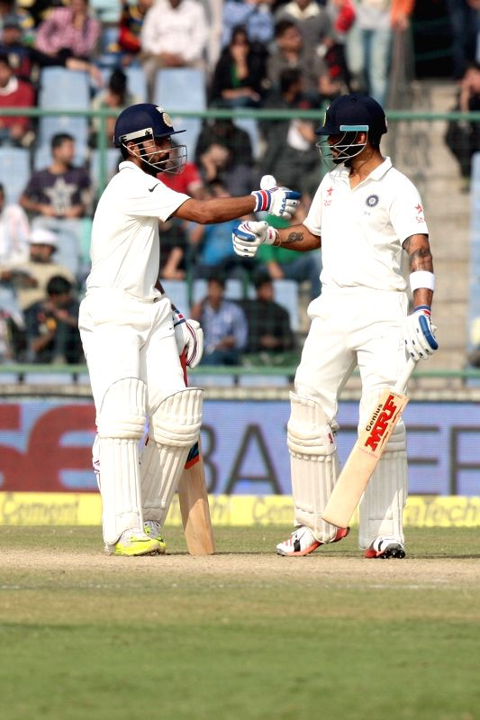 Indian batsmen Ajinkya Rahane and Virat Kohli during the third day of the Fourth and the final test match between India and South Africa at the Feroz Shah Kotla Stadium in New Delhi on ... - Virat Kohli