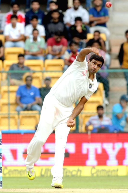 : Indian bowler Ravichandran Ashwin in action during the first day of the second test match between India and South Africa at M Chinnaswamy Stadium in Bengaluru, on Nov 14, 2015. .