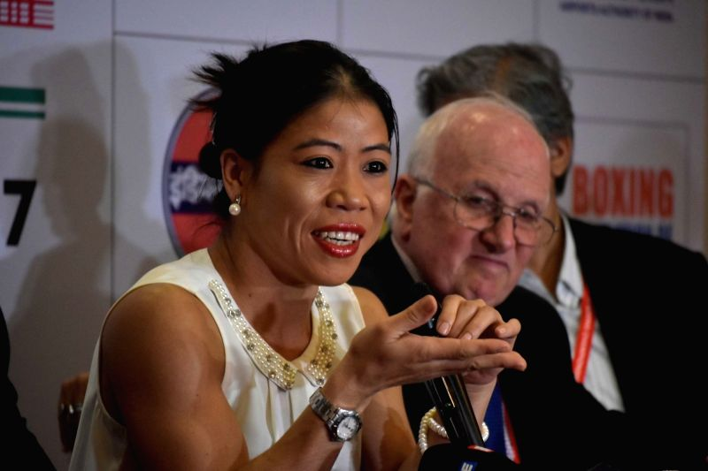 Indian boxer Mary Kom addresses a press conference regarding AIBA Women's Youth World Championships 2017 in Guwahati, on Nov 19, 2017. - Mary Kom