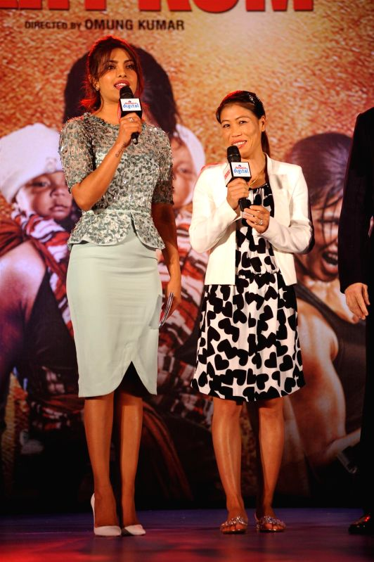 Indian boxer Mary Kom and actor Priyanka Chopra at music event of film Mary Kom in Mumbai on August 13, 2014. - Priyanka Chopra