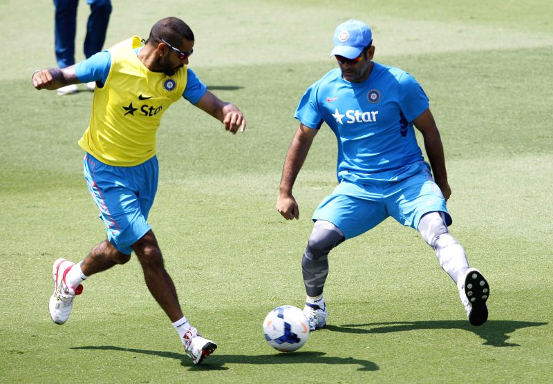 Indian captain M S Dhoni and Shikhar Dhawan in action during a practice session at Melbourne Cricket Ground (MCG) ahead of an ICC World Cup 2015 match - scheduled to be held on 22nd Feb 2015 - ... - M S Dhoni and Shikhar Dhawan