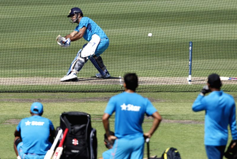 Indian captain M S Dhoni in action during a practice session at Melbourne Cricket Ground (MCG) ahead of an ICC World Cup 2015 match - scheduled to be held on 22nd Feb 2015 - against South Africa, in ... - M S Dhoni