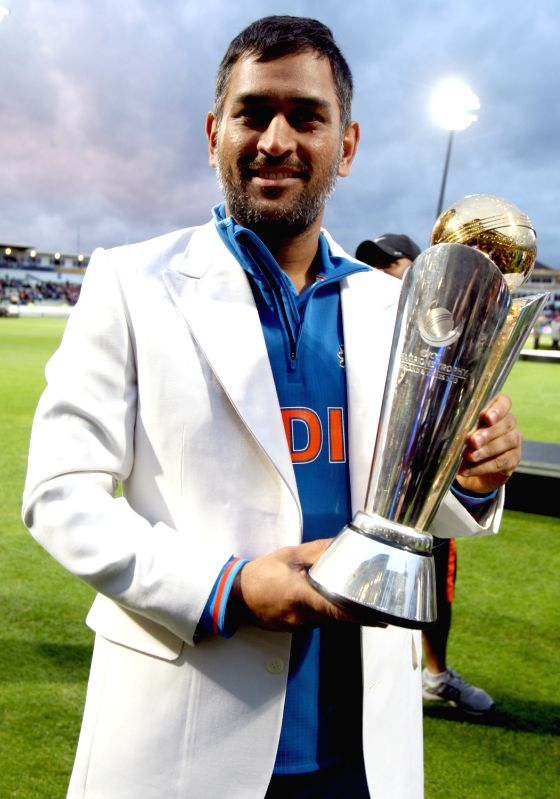 Indian Captain MS Dhoni With The ICC Champions Trophy After Wining Final Match Against Engalnd