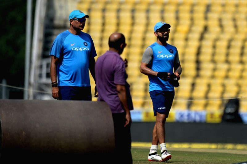 Indian captain Virat Kohli and head coach Ravi Shastri during a practice session ahead of the fifth ODI match against Australia in Nagpur, on Sept 30, 2017. - Virat Kohli