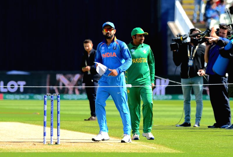 Indian captain Virat Kohli and his Pakistani Counterpart Sarfraz Ahmed during the toss for the ICC Champions Trophy, Group B match between India and Pakistan at Edgbaston, Birmingham, UK ... - Virat Kohli